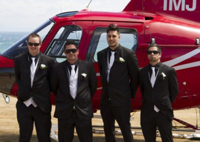 groom & groomsmen having arrived by helicopter to Pencarrow Lodge wedding