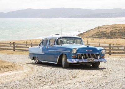 Pencarrow Lodge wedding bride arriving in RokN55 classic car