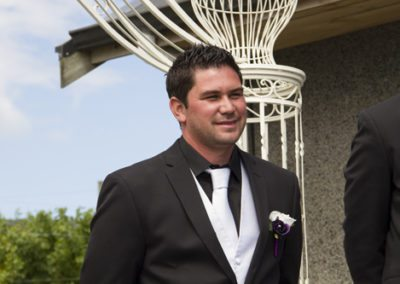 Pencarrow Lodge wedding handsome groom smiling as he first sees bride