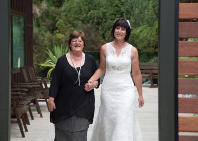bride arriving holding hands with happy older lady