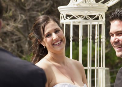 Pencarrow Lodge wedding closeup of bride & groom laughing with celebrant