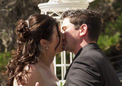 Pencarrow Lodge wedding closeup of bride and groom enjoying first kiss outdoors