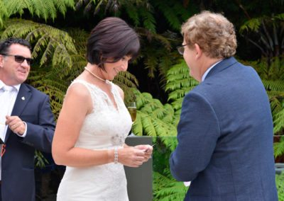 bride & groom with bride reading vows in native bush setting