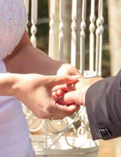 Pencarrow Lodge wedding closeup of bride & groom exchanging rings