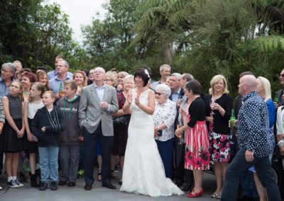 happy wedding group photo outdoors in native bush setting